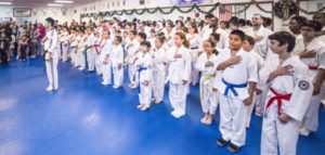Photo shows Master Nam leading our Taekwondo school in the Pledge of Allegiance.