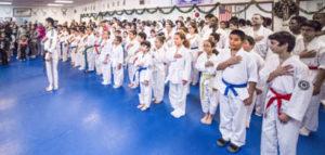 Photo shows Master Nam leading our Taekwondo school in the Pledge of Allegiance.